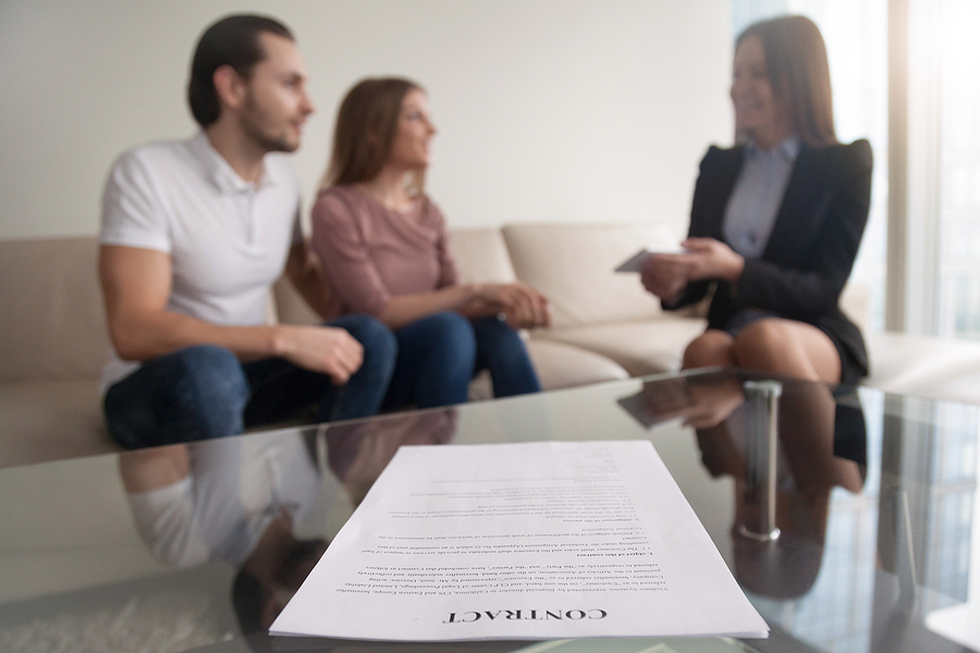 Lawyer assisting a couple on their prenup agreement